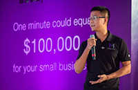 Bin Liu on stage at the Telus pitch competition on behalf of iMerciv