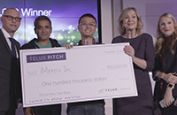 Bin Liu with a giant cheque from Telus